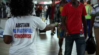 Some members of NGO's do something to mark World Aids Day at park station, Johannesburg by issuing out leaflets and condoms to the commuters. Picture: Motshwari Mofokeng