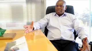 Herman Mashaba with his autobiography, Black Like Me, written with Isabella Morris, during an interview at Fredman Towers in Sandton. It's available for R195 at good bookstores. Picture: Itumeleng English