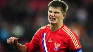 Russia captain Andrei Arshavin has issued an apology for his team's disappointing showing at Euro 2012.