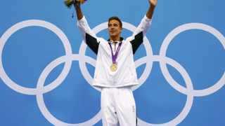 South Africa's Chad le Clos poses with his gold medal after winning the men's 200m butterfly final.