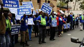 24/04/2012 Motorists cherr on  DA members bearing non e-toll posters as they protes outside the Pretoria High Court while the e-Toll hearing is in session.    Picture: Phill Magakoe