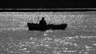 Cape Town 100605. A fisherman is seen near the Knysna Oyster beds using a few rods. PHOTO SAM CLARK