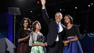 US President Barack Obama with his wife Michelle Obama and daughters Sasha and Malia during his election night victory rally in Chicago.