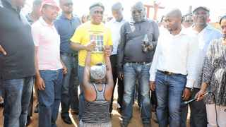 A woman bows down to former president of the ANC youth league Julius Malema in Lenasia extention 13 during his vist to the area to see demolished houses. Picture:Paballo Thekiso