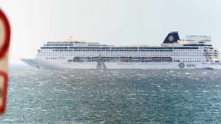 Cape Town. 121210. The Symphonia cruise liner is stuck out at sea just off Cape Town because it can't dock due to heavy winds. Picture Courtney Africa