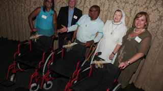 People from different organisation were happy to receive wheelchairs which were donated by John Moshal (second gentleman on the left.Representing different organisation are from left Jennie Reddy from Ntal Settlement Home,Collin Gumede the a teacher at Lihcoh Special School,Sister Brigid from Nazareth House and Linda Nathan the President Council of KwaZulu Jerry.Picture Zanele Zulu,28/01/2013