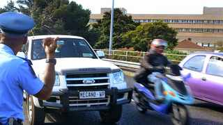 Cape Town-121219- Mayco member for Safety & Security: JP Smith, jumps on board with the City of Cape Town Ghost Squad as they patrol our freeways. Ghost Squad members patrol Hospital Bend during peak hour traffic & also attend a fatal motorcycle accident on the M5 North Bound. Reporter: Natasha Price, Photo: Ross Jansen