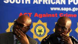 """Police Minister Nathi Mthethwa (L) and Gauteng police commissioner Mzwandile Petros listen to residents duringa visit to Daveyton on Thursday, 14 March 2013 following the recent death of Mozambican taxi driver Mido Macia in police custody.""""We do not want cop tsotsis [police who are criminals]. We must ensure that we clean ourselves up, or lose the trust of the community,"""" Mthethwa said.Picture: Werner Beukes/SAPA"""