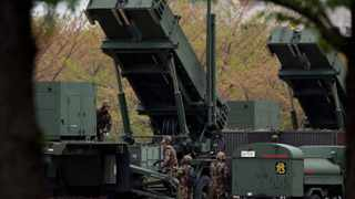 Japanese defence force personnel man a PAC-3 (Patriot Advanced Capability) surface-to-air missile at the compound of the Defence Ministry amid tension over North Korea's possible missile launch.