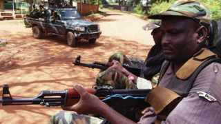 Armed fighters from the Seleka rebel alliance patrol the streets in Bangui.