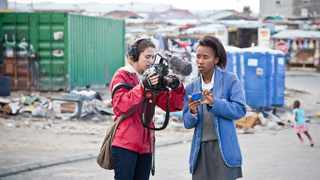 DOCUMENTARY: Wikimedia Foundation camerawoman Charlene Music and Sinenjongo High pupil Nezisa Mdludlu discuss the documentary being made to highlight the school's campaign for free access to Wikipedia on pupils' cellphones. Picture: NATASHA LASSEN