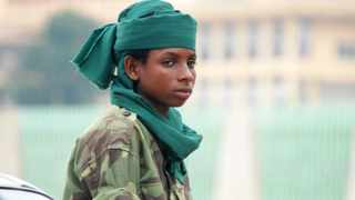 A very young Seleka fighter poses on July 25, 2013 at the Bangui firefighters barracks, turned into a Seleka base.
