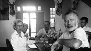 This photo from the mid-20th century shows Ernest Hemingway, second from right, dining with friends. He was a master at balancing his drinking and his work. Picture: AP/John F Kennedy Presidential Library and Museum