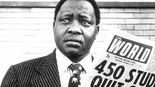 Percy Qoboza, editor of the World and Weekend World, both of which were banned, outside the newspapers offices just before he was detained without trial.