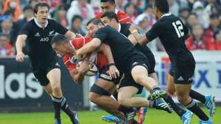 TOKYO, JAPAN - NOVEMBER 02:  Hendrik Tui of Japan is tackled by Dane Coles of New Zealand during the International Rugby Test Match between Japan and the New Zealand All Blacks at Prince Chichibu Memorial Rugby Stadium on November 2, 2013 in Tokyo, Japan.  (Photo by Atsushi Tomura/Getty Images)
