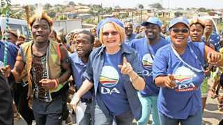 Helen Zille  and her team in campaign mode in Lindelani township near Durban. The writer says the DA leader will likely be confronted by a cacophonous black caucus at the policy conference this weekend. Picture: Patrick Mtolo