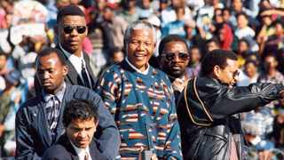 Jeremy Vearey, front left, helps form a human shield around Nelson Mandela in 1994. Photo: OBED ZILWA