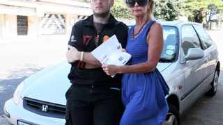 2013/01/15 DURBAN. Helen Ziegler and her son Mark Ziegler holding a e toll fine but their car has never been outside Kwazulu Natal for the past 4 years. PICTURE : SIYANDA MAYEZA