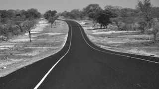 TWO WAY STREET: The Chinese- built road between Sesheke and Mongu on the west bank of the Zambezi, Zambia. China needs Africa to feul its industrial expansion, says the writer. Photo: Tony Weaver