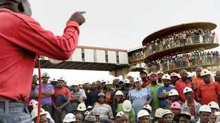 Around 500 miners gather in song outside the Doornkop Mine to mourn 8 lives who died there on Thursday. The where joined by the chairman Patrice Motsepe and Minister Susan Shabangu.  Picture: Timothy Bernard  06.02.2014