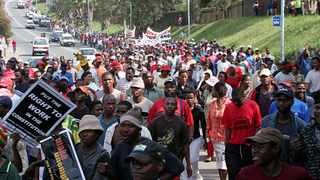 People from Kennedy Road settlement, Durban, march to their local councillors office to protest against poor living conditions. Protesters, police and public representatives need to alter course to resolve public violence, analysts say.