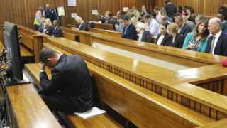 Oscar Pistorius sits in the dock ahead of the second day of the trial of the Olympic and Paralympic track star at the North Gauteng High Court in Pretoria. Photo: Kim Ludbrook/ Pool