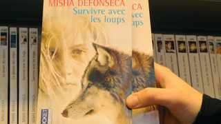 A Dutch edition of Misha: A Memoire Of The Holocaust Years by Misha Defonseca is seen at the Dilbeek library. File picture: Belga Herwig Vergult