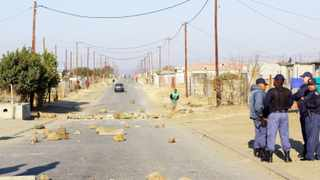 Ladysmith police monitor the situation in Steadville, a township 6km from the KwaZulu-Natal town. Photo: Claudine Senekal