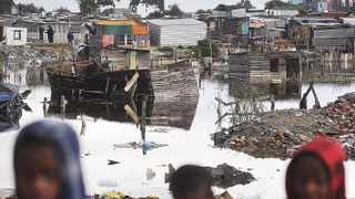 Cape Town. 140706. Sithole informal settlement opposite Mitchells Plain floods periodically. Kids walk through the rubble. Pic COURTNEY AFRICA