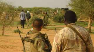 French soldiers stand guard at the crash site of Air Algerie Flight AH5017 near the northern Mali town of Gossi on July 24, 2014. Picture: Souleymane ag Anara