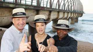 uMhlanga's distinctive whale bone pier is the world's most beautiful, say proud tourism experts, from left, Peter Rose, chairman of uMhlanga Tourism, Briony Smith, TKZN manager for Africa and the domestic market, and Phillip Sithole, head of Durban Tourism.   Picture: Jacques Naude