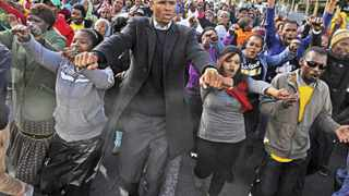 Cape Town 140813- Loyiso Nkohla sings outside Bellville  magistrate court with Seskhona members. Picture Cindy waxa.Reporter Kieran/Argus