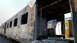 Cape Town-140821-Burnt out Metrorail train in Salt river Depot-Reporter-Murray-Photographer-Tracey Adams