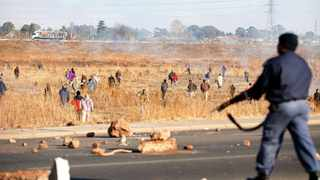 672 01.09.2014 Police officer fire rubber bullets to protesting Grasmere township residents who took to the streets to fight against lack opf service delivery, south of Gauteng. Picture; Itumeleng English