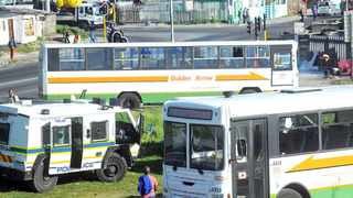 Cape Town - 140902 - Pictured are Golden Arrow busses at a temporary bus station outside Nyanga after several busses were torched. Reporter: Chelsea Geach Picture: David Ritchie (083 652 4951)