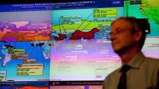 Dr. Stephan Monroe, deputy director of the national centre for emerging and zoonotic infectious diseases, stands in front of a map in the Centers for Disease Control and Prevention (CDC) Emergency Operations Center in Atlanta.