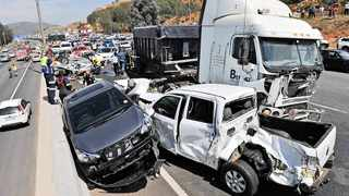 151014:  Scene of the horror multiple car pile up that was alledgedly caused by a speeding runaway truck on the N12 East near the Voortrekker off ramp, Alberton.  Picture: Antoine de Ras, 14 oct 2014