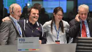 A handout picture shows ESA employees (left to right)  Stephan Ulamec, Andrea Accomazzo, Elsa Montagnon and Paolo Ferri  in the main control room of the European Space Agency in Darmstadt, Germany.  EPA/Esa - J.Mai / HANDOUT