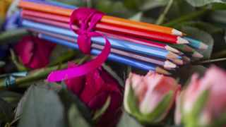 Pencils and flowers are placed at the French embassy at Pariser Platz in Berlin. The writer says international courts have often condoned restrictions on freedom of expression, when it comes to religion.  	Picture: Hannibal Hanschke