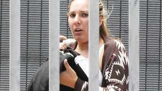 Capetown-150115-Jolana-Jo Huysamer leaving Wynberg court after she was granted bail. where she appeared on charges of racial abuse-Picture by BHEKI RADEBE