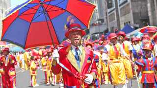 Cape Town - 150117.The 2015  New Year's Minstrel Carnival took place today in the CBD starting from Kaizergracht Street and marching up to the BoKaap. Here Harry Jacob from the fabulous woodstock starlites performs in front of the crowds. reporter: kowthar solomons. Pic : jason boud
