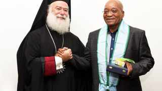 "President Jacob Zuma is seen with  Pope and Patriarch of the Greek Orthodox Church of Alexandria and All Africa: Theodoris II in Pretoria  on Sunday, 18 January 2015. He bestowed Zuma with the highest honour the church can give to a foreign national - the Order of Saint Mark. ""With this I give you great blessing,"" Theodoris II said speaking through an interpreter as he handed Zuma a personal cross and a certificate. Picture: Department of Communications (DoC)/SAPA"