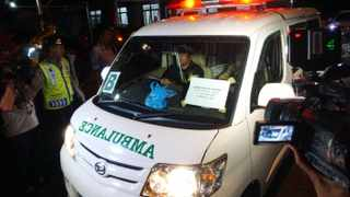 An ambulance carrying the coffin of Marco Archer Cardoso of Brazil arrives from Nusakambangan Island prison complex at Wijayapura port, after his execution. Picture: BAYU NUR