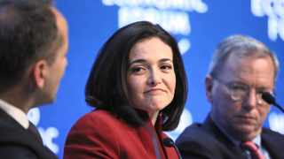 Sheryl Sandberg, billionaire and chief operating officer of Facebook (centre), and Eric Schmidt, the chairman of Google (right), listen as Jim Hagemann Snabe, a board member of the World Economic Forum, speaks during a session on day two of the forum in Davos, Switzerland, last week. World leaders, influential executives, bankers and policymakers attended the meeting. Photo: Bloomberg.