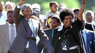 LON99:SAFRICA-ELECTIONS-MANDELA:JOHANNESBURG,10FEB00 - FILE PHOTO 11FEB90 - TO MATCH FEATURE BC-PEOPLE-SAFRICA-MANDELA - In the ten years since his walk to freedom, Nelson Mandela, now 81, has packed more into life than most young men. Mandela, who spent 27 years in apartheid jails as the world\'s most important political prisoner, walked free from Victor Verster prison, near Cape Town, on February 11, 1990. Mandela is accompanied by his former wife Winnie, moments after his release from prison in this February 11, 1990 file photo.   km/Photo by Ulli Michel   REUTERS
