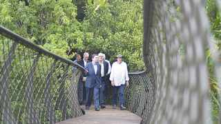 Fee Bearing - Cape Town - In the middle Ministers of Tourism Derek Hanekom walk along the Boomslang bridge in Kirstenbosch Gardens next to the Secretory General of the United Nations World Tourism Organization (UNWTO) Taleb Rifai (left) and the Boomslang Treetop Canopy Walk's architect Mark Thomas (right).  Reporter: Melanie Gosling. Photo by Armand Hough
