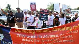 Friends of the slain lesbian Duduzile Zozo protest outside the Palm Ridge Magistrates Court in November last year when Lesley Motleleng was sentenced to 30 years imprisonment for her murder. Picture: Motshwari Mofokeng