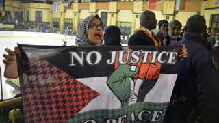 Cape Town – 150416 – Amaarah Arendse holding a Palestinian flag at the match. Grand West Casino Security unlawfully detained and assaulted three spectators at an ice hockey tournament between Israel and South Africa for shouting pro Palestinian chants. Photographer: Armand Hough