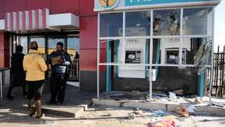 080615. Dube in Soweto. Dube community members protested against loadshedding last night damaging KFC and FNB ATM and looting the bottle store. 092 Picture: Dumisani Sibeko