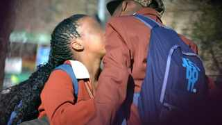 056 07.05.2013 School pupil kiss in a public area after school hours at Johannesburg City, Beyersnaude Square, they walk around town wearing school uniform holding hands. Picture: Motshwari Mofokeng